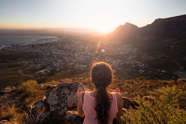 woman meditating on lion's head